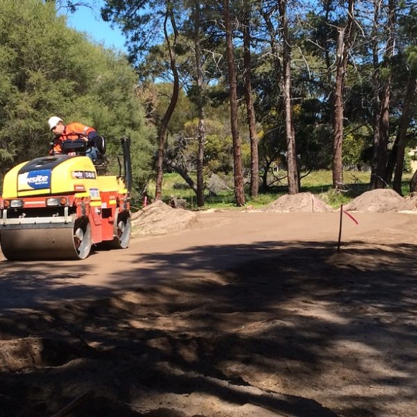pathway at Rottnest island burial site being rolled ready for limestone